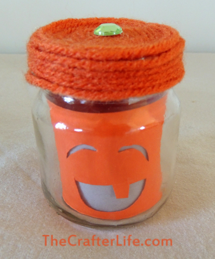 Pumpkin, baby food jar, candle